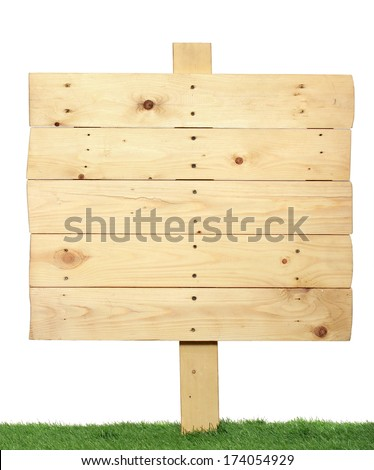 Wooden sign isolated on white. Wood old planks sign on the green grass - stock photo