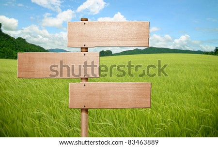 wooden sign on field grass mountain - stock photo
