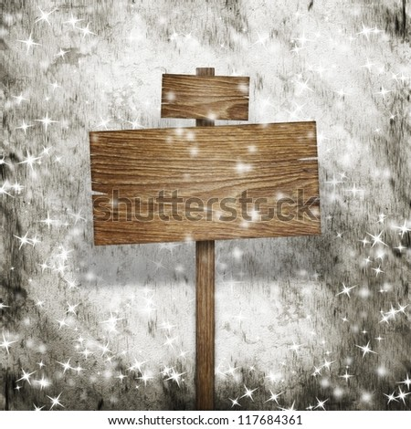 Wooden sign over snow grunge background - stock photo