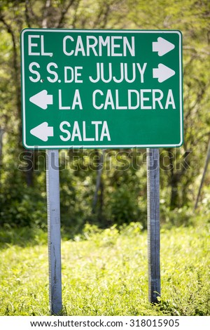 Wooden sign post with the direction to Salta and San Salvador de Jujuy on the famous ruta 40 (Route 40) in Jujuy  Province, Northern Argentina - stock photo