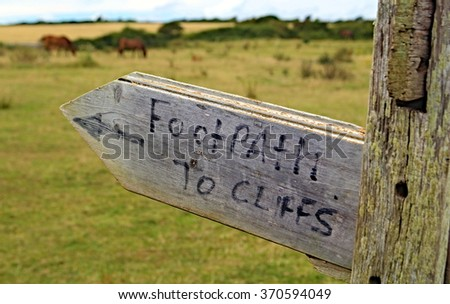 "Wooden sign saying ""Footpath to Cliffs"" - stock photo"