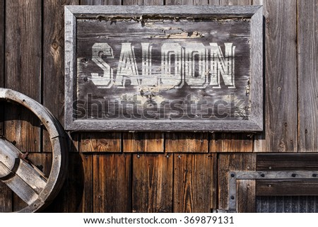 wooden sign with word saloon, planks on the background, vintage style