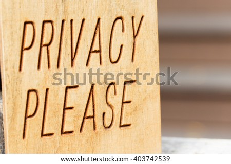 "wooden sign with words ""privacy please"" at the hotel - stock photo"