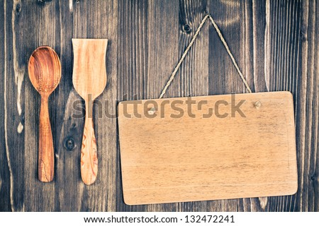 Wooden signboard hanging wall background, spoon, spatula - stock photo