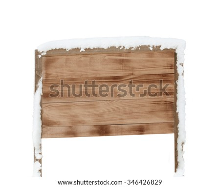 wooden signboard in snow isolated on white background. - stock photo