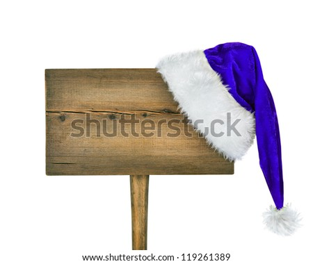 Wooden signboard with blue Christmas hat isolated on white background