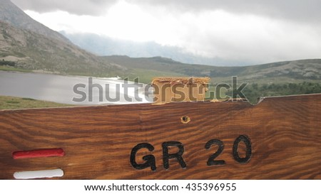 wooden signpost for hikers in Corsica along the GR 20 - stock photo