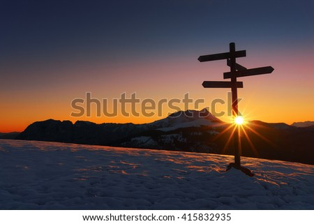 wooden signpost in Saibi with view of Anboto mountain at sunrise