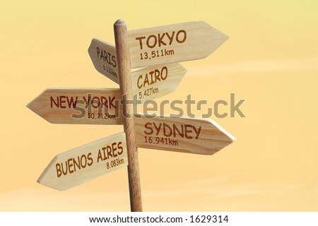Wooden signpost indicating six world capitals with distances in kilometers - stock photo