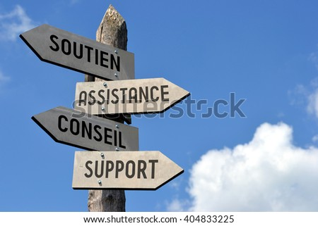 "Wooden signpost with arrows and text in French- ""Soutien, Assistance, Conseil, Support"" (""help, support, advice, guidance"" in English). Great for business presentations, as customer support motive. - stock photo"