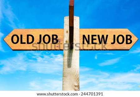 Wooden signpost with two opposite arrows over clear blue sky, Old Job and New Job, Career change conceptual image - stock photo