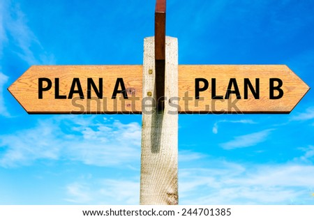 Wooden signpost with two opposite arrows over clear blue sky, Plan A and Plan B, Right choice conceptual image  - stock photo