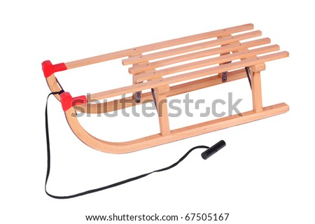 Wooden sled for a kid, isolated against background