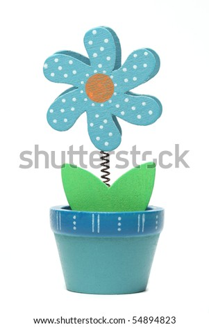 wooden small flower in flowerpot isolated - stock photo