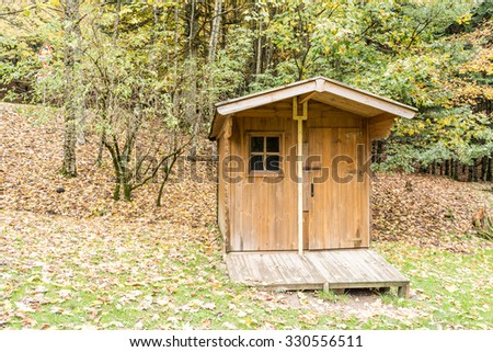 Wooden small house nestled in the forest