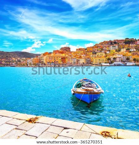 Wooden small old boat in Porto Santo Stefano seafront, italian travel destination. Monte Argentario, Tuscany, Italy. - stock photo