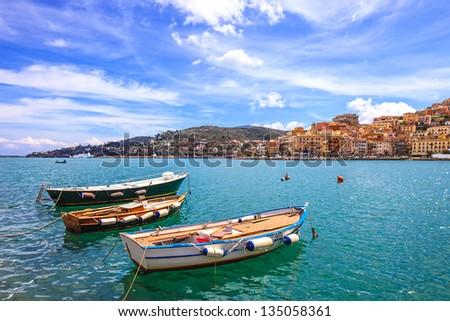 Wooden small old boats in Porto Santo Stefano seafront, italian travel destination. Monte Argentario, Tuscany, Italy. - stock photo