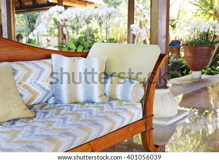 wooden sofa with pillows - stock photo
