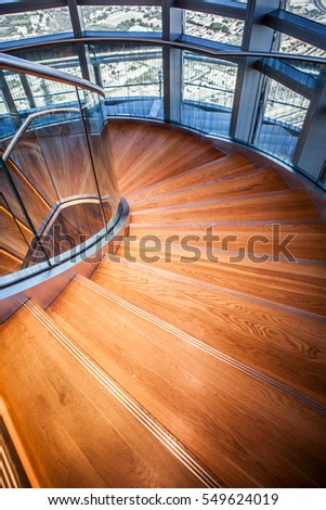 Wooden spiral stairs with rails in interior. wood spiral stairca