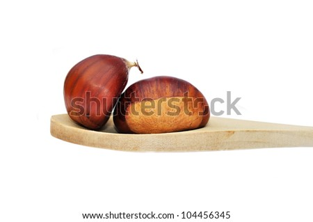 Wooden spoon and chestnuts isolated on white background