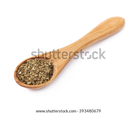 Wooden spoon and dried basil