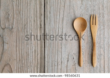Wooden spoon and fork on table - stock photo