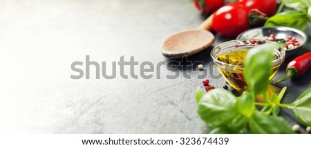 Wooden spoon and ingredients on old background. Vegetarian food, health or cooking concept. - stock photo