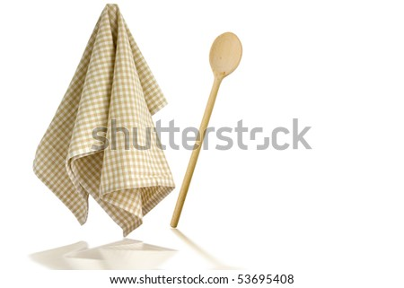 Wooden spoon and kitchen towel, isolated on white background