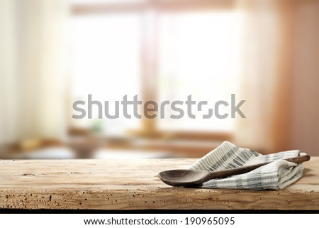 wooden spoon and napkin with window  - stock photo