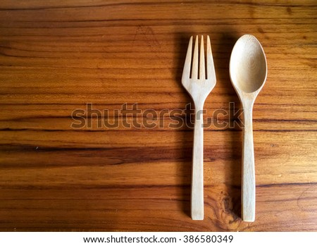Wooden spoon and on the wooden table  top view - stock photo