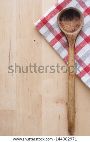 wooden spoon and towel - stock photo