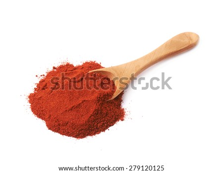 Wooden spoon covered with the red chili paprika powder isolated over the white background - stock photo
