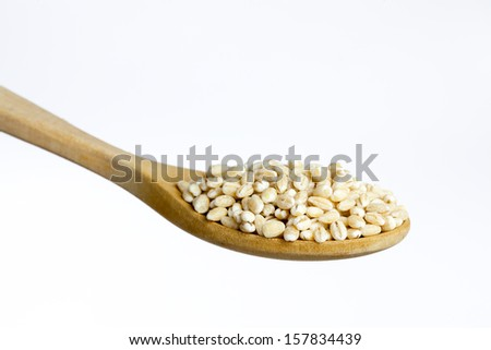 Wooden spoon, full of pearled barley, isolated on white background