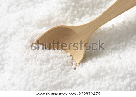 wooden spoon immersed in the portion of pure sea salt - stock photo