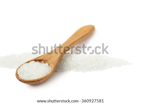 Wooden spoon of the rock salt - stock photo