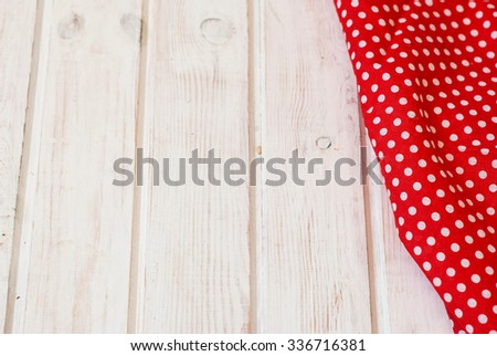 Wooden spoon on table with towel napkin background - stock photo