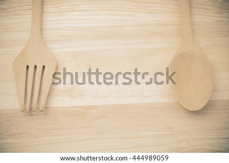 Wooden spoon on wood table with filter effect retro vintage style - stock photo