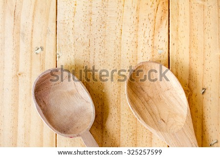 Wooden Spoon on wooden Table - stock photo
