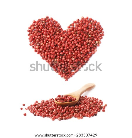 Wooden spoon over the pile of the red pepper seeds and heart shape over it, composition isolated over the white background - stock photo