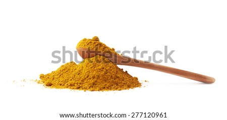 Wooden spoon over the pile of yellow curry powder isolated over the white background - stock photo