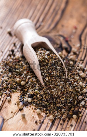 Wooden spoon with crushed Peppercorns (detailed close-up shot) - stock photo