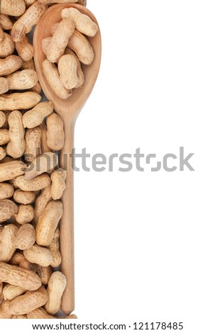 Wooden spoon with peanut  isolated on white background - stock photo