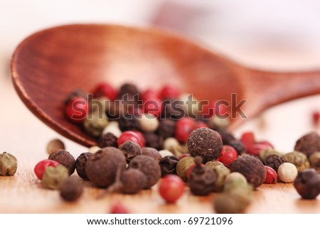 Wooden spoon with pepper, close up - stock photo