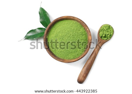 Wooden spoon with powdered matcha green tea in bowl, isolated on white