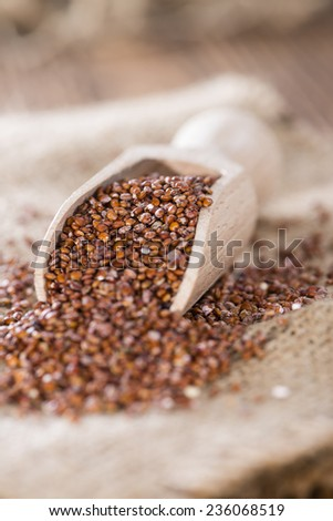 Wooden spoon with red Quinoa (detailed close-up shot) - stock photo