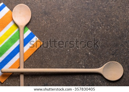 wooden spoons and napkin color lie on the surface - stock photo