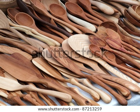 Wooden spoons and other kitchen instruments. - stock photo