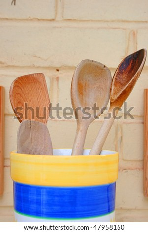 wooden spoons in container. - stock photo
