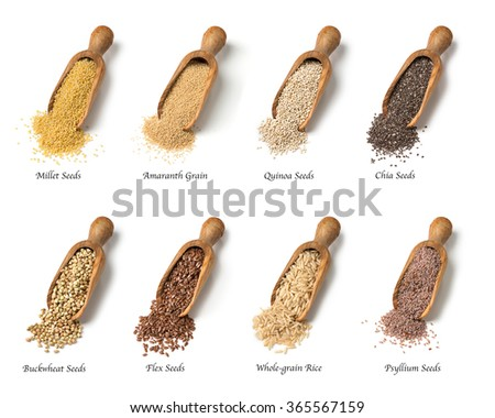 Wooden spoons with gluten free seeds - stock photo