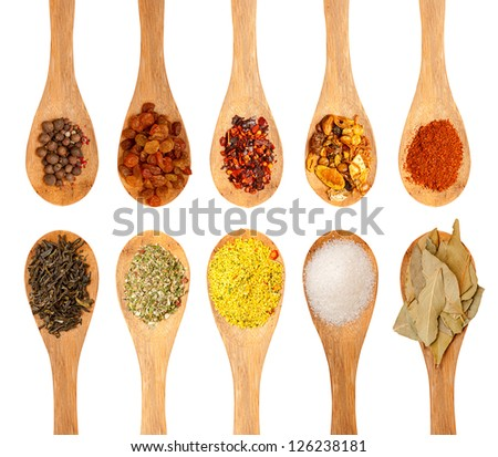 wooden spoons with seasonings on a white background, each one is shot separately